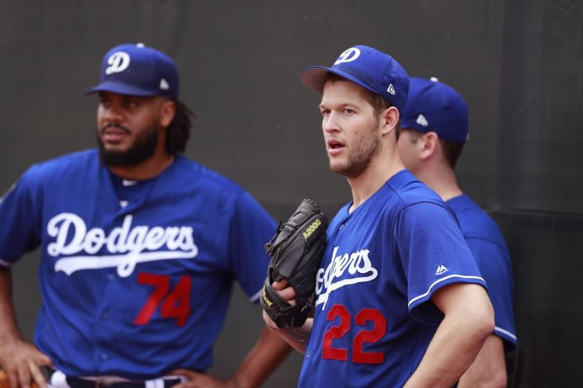 Los Angeles Dodgers starting pitcher Clayton Kershaw (22) stands with relief pitcher Kenley Jansen (74) and starting pitcher Rich Hill during workouts at the team's spring training baseball facility Wednesday, Feb. 14, 2018, in Glendale, Ariz. .(AP Photo/Carlos Osorio)