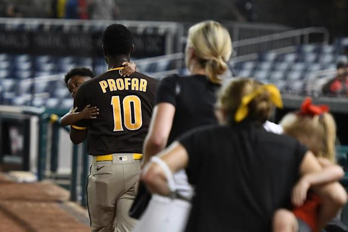 WASHINGTON, DC - JULY 17: Jurickson Profar #10 of the San Diego Padres runs off the field with family after what was believed to be shots were heard during a baseball game between the San Diego Padres and the Washington Nationals at Nationals Park on July 17, 2021 in Washington, DC. (Photo by Mitchell Layton/Getty Images)