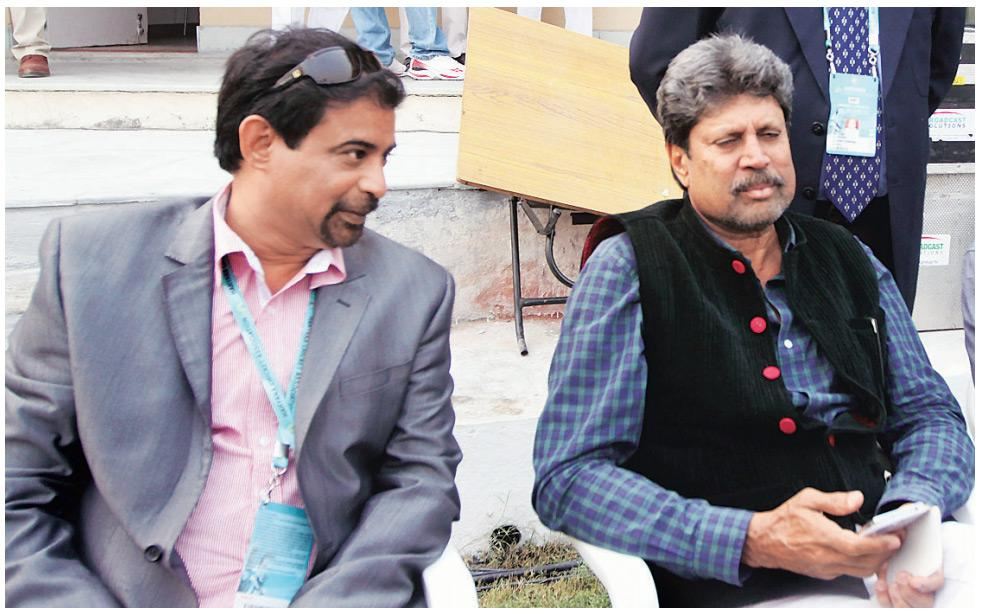 Members of the 1991 Ranji Trophy winning team Chetan Sharma (left) and Kapil Dev in Lahli on October 27, 2013 during the match between Mumbai and Haryana. (Mail Today)