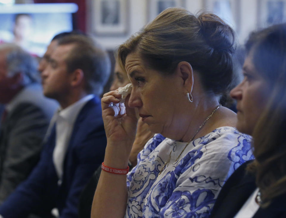 Gail Box, the mother of former University of Oklahoma football player Austin Box, who died of a drug overdose in 2011, listens during closing arguments in Oklahoma's ongoing opioid drug lawsuit against Johnson & Johnson Monday, July 15, 2019, in Norman, Okla. (AP Photo/Sue Ogrocki)