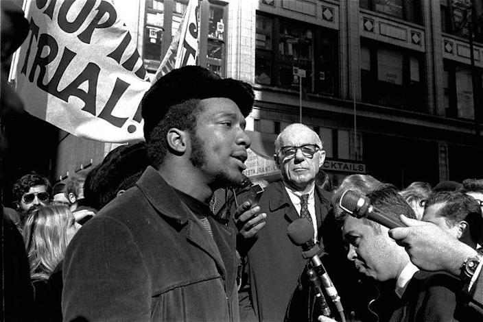 """In this Oct. 29, 1969, file photo, Fred Hampton, center, chairman of the Illinois Black Panther party, speaks outside a rally outside the U.S. Courthouse in Chicago while Dr. Benjamin Spock, background, listens. """"The First Rainbow Coalition,"""" a new PBS documentary, is exploring a little-known movement in 1960s Chicago that brought together blacks, Latinos, and poor whites from Appalachia that later resulted in the upending of politics in the American Midwest."""