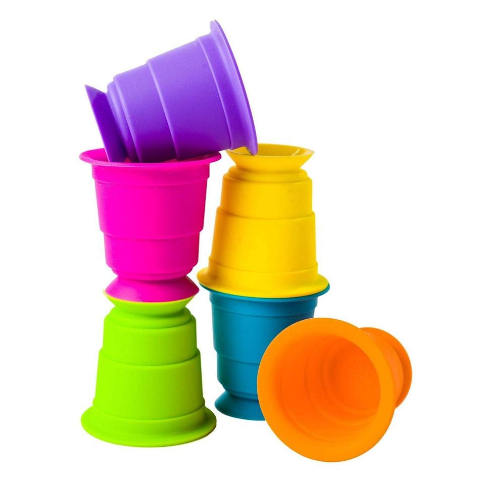 <p>Six silicone suction cups in various colors make bath time, table time, or floor time more fun! The <span>Fat Brain Toys Baby Toddler and Learning Toy Suction Kupz</span> ($15) can be stacked, stuck to the table or walls, and hide snacks or small toys!</p>
