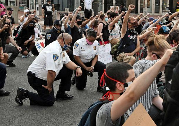 PHOTO: Baltimore City Police Commissioner Michael Harrison takes a knee with protestors as they halt their march for more than eight minutes to remember the time George Floyd struggled under the knee of a former Minneapolis police officer on June 4, 2020. (Kim Hairston/TNS via Newscom, FILE)