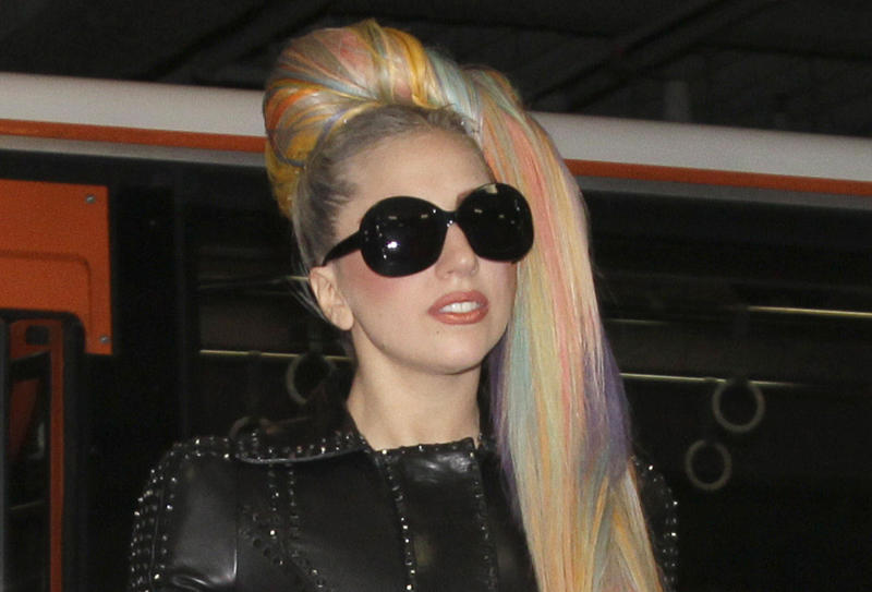 """In this photo taken on Tuesday, May 8, 2012, Lady Gaga arrives at Narita International Airport in Narita, east of Tokyo. Lady Gaga might have to cancel her sold-out show in Indonesia because Islamic hard-liners and conservative lawmakers objected. National police spokesman Boy Rafli Amar said the permit was denied for the June 3, 2012,  """"Born This Way"""" concert that was to be the biggest show on her Asian tour. (AP Photo/Shizuo Kambayashi)"""