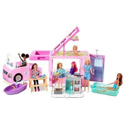 """<p><strong>Barbie</strong></p><p>target.com</p><p><strong>$79.00</strong></p><p><a href=""""https://www.target.com/p/-/A-76620579"""" rel=""""nofollow noopener"""" target=""""_blank"""" data-ylk=""""slk:Shop Now"""" class=""""link rapid-noclick-resp"""">Shop Now</a></p><p>Camping-themed toys are a huge trend this year, and <strong>this Barbie camper is like three toys in one</strong>. It opens and unhitches to form a boat and a pickup truck, and the camper itself has a living room, pool, bathroom with a pop-up shower, rooftop bedroom and a kitchen — lots of areas to spark imaginative play. <em>Ages 3+</em></p>"""