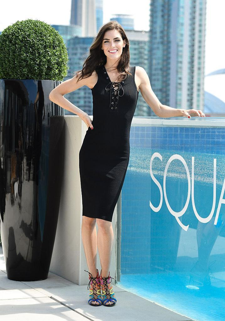 <p>The supermodel attended an event at Square One in Mississauga in a form-fitting black dress accessorized with look-at-me rainbow sandals. <i>(Photo by George Pimentel/WireImage)</i><br></p>