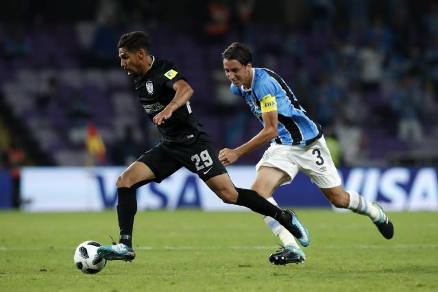 Mexico's Pachuca Franco Jara, left, controls the ball as Brazil's Gremio Pedro Geromel tries to stop him during the Club World Cup semifinal soccer match between Gremio and Pachuca at the Hazza Bin Zayed stadium in Al Ain, United Arab Emirates, Tuesday, Dec. 12, 2017. (AP Photo/Hassan Ammar)