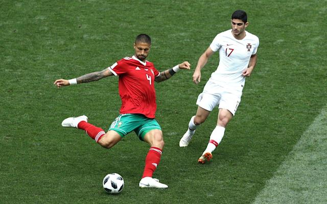 1:14PM 14 mins - Portugal 1 Morocco 0 The Moroccans are pushing hard at the moment, forcing Portugal deep inside their own half and winning another corner. It is only half-cleared before being delivered again for Da Costa to head well wide. 1:13PM 13 mins - Portugal 1 Morocco 0 A couple of nice Ronaldo stats: 85 - Cristiano Ronaldo has now scored more international goals than any other European player in the history of football (85 goals for Portugal). Historic. #POR#MAR#PORMAR#Ronaldo#WorldCuppic.twitter.com/I3wsEJTGlQ— OptaJoe (@OptaJoe) June 20, 2018 2 - Cristiano Ronaldo has become the first Portugal player since José Torres in 1966 to score a goal with his right foot, left foot and head in a single World Cup tournament. Collection. #POR#MAR#PORMAR#Ronaldo#WorldCuppic.twitter.com/liZrUSyXmq— OptaJoe (@OptaJoe) June 20, 2018 1:12PM 11 mins - Portugal 1 Morocco 0 Credit to Morocco, they haven't responded too badly to going behind and Amrabat is causing problems against an ageing (actually, very much aged) Portugal defence down the right. The north African side win a corner, which finds Da Costa unmarked in the middle of the box and his header is held on the line by Patricio diving low to his right. 1:10PM 9 mins - Portugal 1 Morocco 0 Here comes Ronaldo again. Guerreiro is allowed far, far too much space to bring the ball deep inside Morocco's half. Inside it comes to Ronaldo, who attempts to let fly from the edge of the penalty area but scuffs his shot wide of the post. He's in the mood. 1:07PM 6 mins - Portugal 1 Morocco 0 That was such poor marking and Ronaldo is just too good for that. Morocco's World Cup 2018 future is dangling by a thread. 1:05PM GOOOOOOOOOOOAAAAAAAL And you don't even need me to tell you who scored it. The corner is whipped to the edge of the six-yard box where Ronaldo is woefully marked. The Real Madrid man flings himself powerfully at the ball and bullets a header past Mohamedi in goal to put Portugal ahead. Portugal 1 - 0 Morocco (Cristi