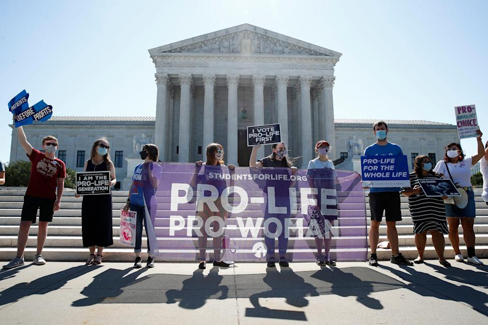 Anti-abortion protesters wait outside the Supreme Court for a decision on Russo v. June Medical Services on June 29, 2020.  Louisiana voters will decide whether to enshrine anti-abortion language in the state constitution.