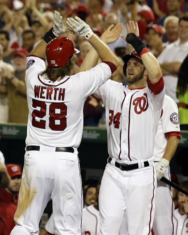 Washington Nationals' Jayson Werth (28) celebrate his three-run home run with Bryce Harper during the sixth inning of a baseball game against the Miami Marlins at Nationals Park, Thursday, Aug. 29, 2013, in Washington. (AP Photo/Alex Brandon)