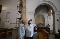 Monsignor Roberto González, the archbishop of San Juan, points as he and businessman Ricardo Gonzalez stand inside the San Jose Church after its reconstruction in San Juan, Puerto Rico, Tuesday, March 9, 2021. The $11 million restorations became a personal project for González that took nearly two decades to complete. (AP Photo/Carlos Giusti)