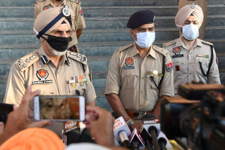Punjab Police speak to media in Tarn Taran district on August 1, 2020 after dozens of people died from poisoned alcohol
