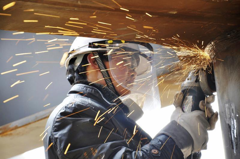 A labourer works inside a factory in Qingdao