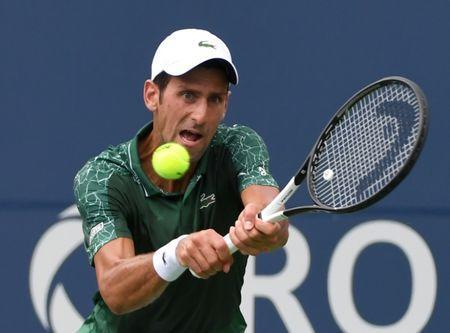 FILE PHOTO: Aug 7, 2018; Toronto, Ontario, Canada; Novak Djokovic of Serbia plays a shot against Mirza Basic of Bosnia and Herzegovina (not shown) in the Rogers Cup tennis tournament at Aviva Centre. Mandatory Credit: Dan Hamilton-USA TODAY Sports