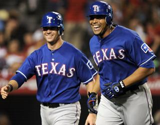 Michael Young (left) and Nelson Cruz react after Cruz homered in an 8-4 win over the Angels on Aug. 15