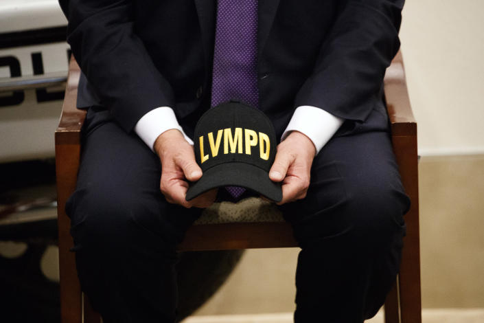 <p>President Donald Trump holds a Las Vegas Metropolitan Police Department hat as he meets with first responders, Wednesday, Oct. 4, 2017, in Las Vegas, Nev.. (Photo: Evan Vucci/AP) </p>