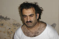 """FILE - In this March 1, 2003 file photo obtained by The Associated Press, Khalid Sheikh Mohammed is seen shortly after his capture during a raid in Pakistan. The leading propagandist of al-Qaida, labeled the """"principal architect of the 9/11 attacks"""" by the 9/11 Commission, he was captured by the CIA and Pakistan's secret police, then spirited to CIA prisons in Poland and Afghanistan and finally to Guantanamo. (AP Photo/File)"""