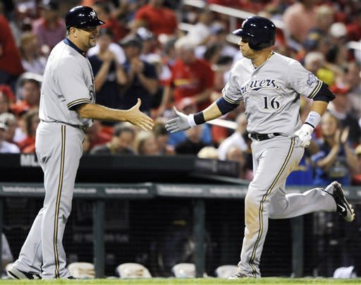 Milwaukee Brewers' Aramis Ramirez (16) is congratulated by third base coach Ed Sedar, left, on his solo home run against the St. Louis Cardinals in the ninth inning of a baseball game, Saturday, Sept. 8, 2012, at Busch Stadium in St. Louis. (AP Photo/Bill Boyce)