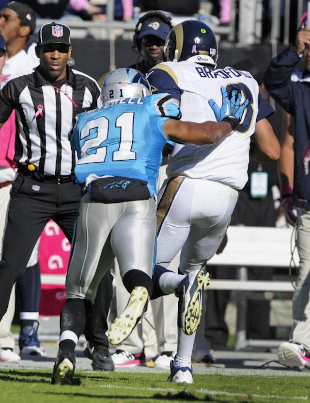 St. Louis Rams' Sam Bradford (8) is pushed out of bounds by Carolina Panthers' Mike Mitchell (21) in the second half of an NFL football game in Charlotte, N.C., Sunday, Oct. 20, 2013. Bradford was injured on the play. (AP Photo/Mike McCarn)
