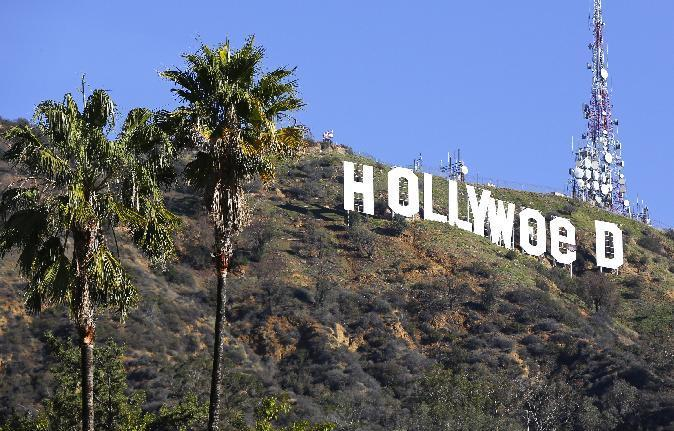 "FILE - In this Sunday, Jan. 1, 2017, file photo, the Hollywood sign is seen vandalized. Los Angeles residents awoke New Year's Day to find a prankster had altered the famed Hollywood sign to read ""HOLLYWeeD."" Police have also notified the city's Department of General Services, whose officers patrol Griffith Park and the area of the rugged Hollywood Hills near the sign. California voters in November approved Proposition 64, which legalized the recreational use of marijuana, beginning in 2018. (AP Photo/Damian Dovarganes, File)"