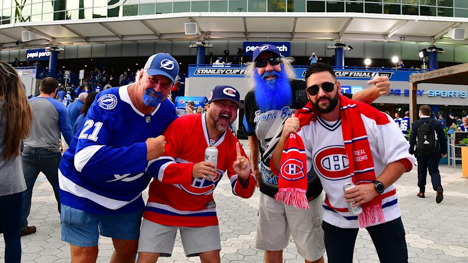 TAMPA, FLORIDA - JUNE 28:  Fans pose for a photo prior to Game One of the 2021 NHL Stanley Cup Final between the Tampa Bay Lightning and the Montreal Canadiens at Amalie Arena. (Photo by Julio Aguilar/Getty Images)