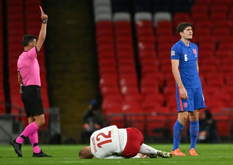 Maguire sent off as Denmark hand England first defeat in a year