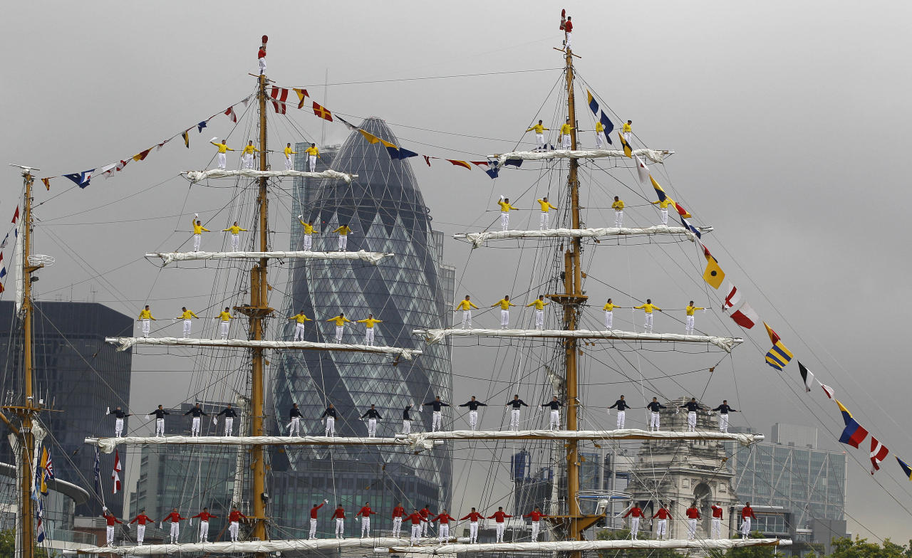 Cadets are seen on the masts singing the ship's anthem as Colombian Navy's training ship Arc Gloria sails towards Tower Bridge on the River Thames in London, Friday, Aug. 26, 2011. One of the biggest tall ships in the world, which is still in service, the ship is on a three day visit to London. It is almost 20 years since the Colombian Navy's ship Gloria last sailed into London, this time on a goodwill tour of the world, received over 7,000 visitors during its time in the city.(AP Photo/Kirsty Wigglesworth)