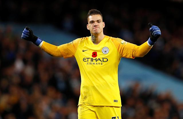 """Soccer Football - Premier League - Manchester City v Manchester United - Etihad Stadium, Manchester, Britain - November 11, 2018 Manchester City's Ederson celebrates after the match Action Images via Reuters/Jason Cairnduff EDITORIAL USE ONLY. No use with unauthorized audio, video, data, fixture lists, club/league logos or """"live"""" services. Online in-match use limited to 75 images, no video emulation. No use in betting, games or single club/league/player publications. Please contact your account representative for further details."""