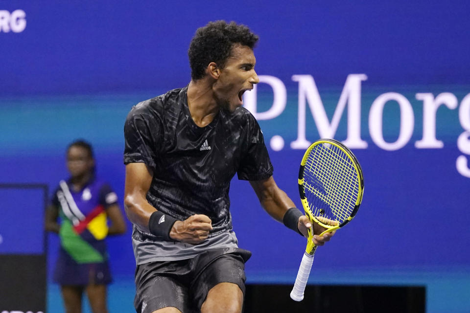 Felix Auger-Aliassime, of Canada, reacts after winning a game against Frances Tiafoe, of the United States, during the fourth round of the US Open tennis championships, Sunday, Sept. 5 2021, in New York. (AP Photo/Frank Franklin II)