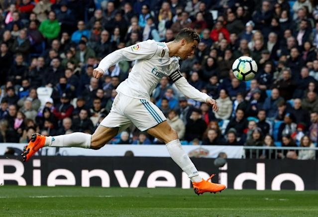 Soccer Football - La Liga Santander - Real Madrid vs Deportivo Alaves - Santiago Bernabeu, Madrid, Spain - February 24, 2018 Real Madrid's Cristiano Ronaldo heads at goal REUTERS/Juan Medina TPX IMAGES OF THE DAY