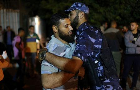 he brother of a Palestinian Hamas gunman, who was killed in an explosion, is consoled at a hospital in the central Gaza Strip