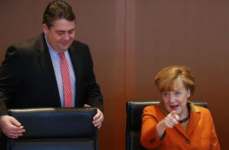 File photo of German Chancellor Merkel and Economy Minister Gabriel arriving for the weekly cabinet meeting in Berlin