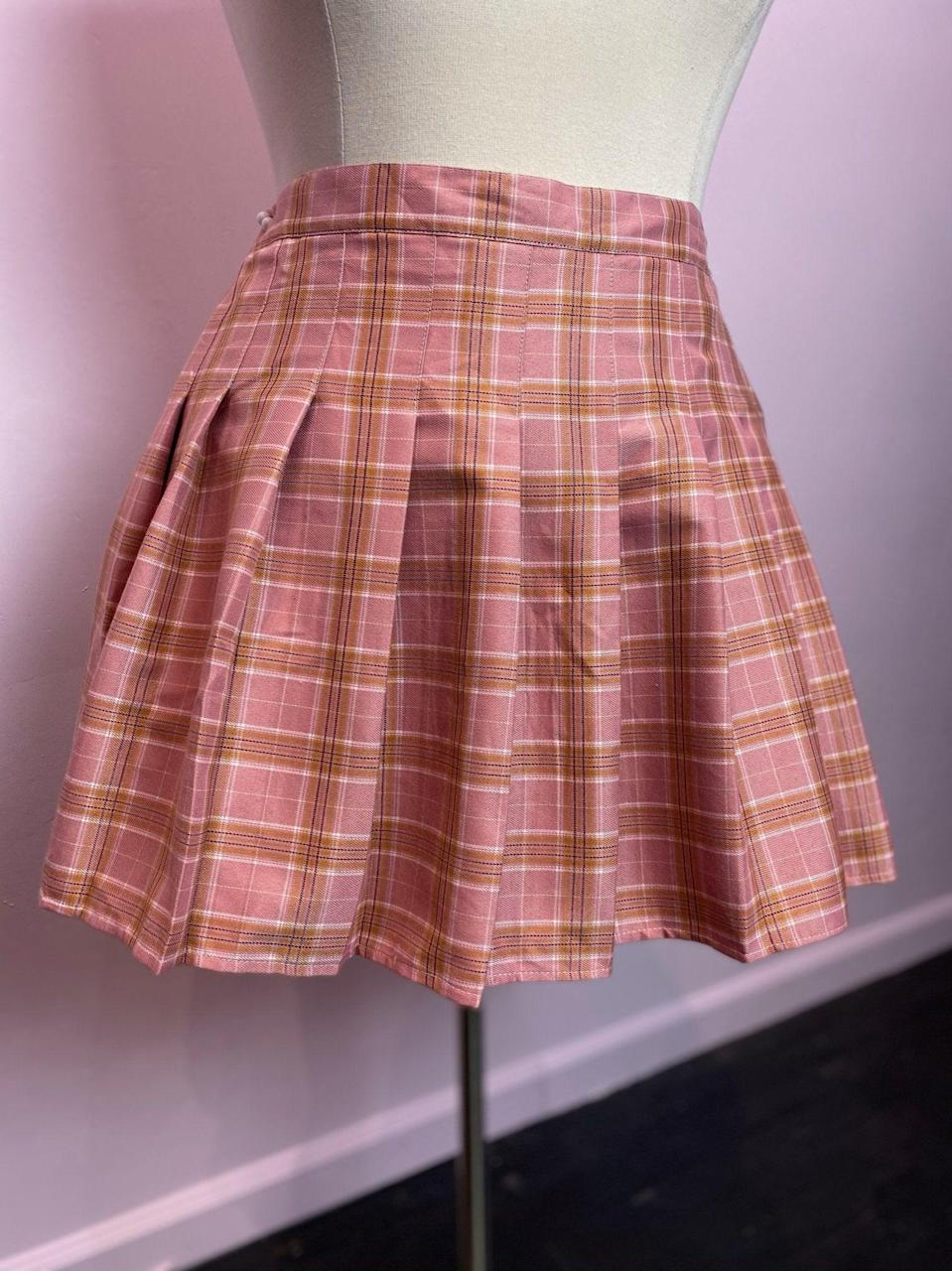 "<br><br><strong>Vintage</strong> Pink and Yellow Plaid Pleated Skort, Size 3X, $, available at <a href=""https://go.skimresources.com/?id=30283X879131&url=https%3A%2F%2Fwww.theplus-bus.com%2Fcollections%2Fall-new%2Fproducts%2Fskt"" rel=""nofollow noopener"" target=""_blank"" data-ylk=""slk:The Plus Bus"" class=""link rapid-noclick-resp"">The Plus Bus</a>"