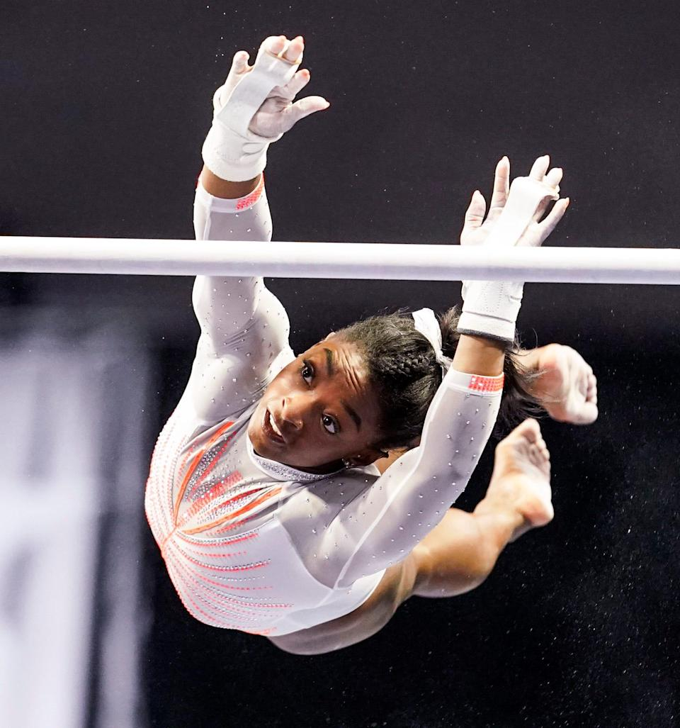 Simone Biles competes on the uneven bars in May 2021.