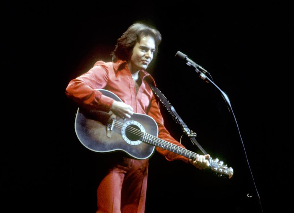 LOS ANGELES - CIRCA 1980: Singer Neil Diamond performs onstage wearing a red jumpsuit in circa 1980 in Los Angeles, California. (Photo by Michael Ochs Archives/Getty Images)