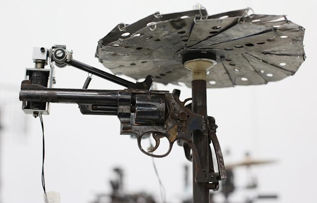 LONDON, ENGLAND - MARCH 26: An automated musical instrument made from recycled gun parts is shown at Pedro Reyes' exhibition at the Lisson Gallery on March 26, 2013 in London, England. Mexican artist Pedro Reyes received 6,700 destroyed weapons from the Mexican government from which he sculpted two groups of instruments. The first, a series titled Imagine, is an orchestra of fifty instruments, from flutes to string and percussion instruments, designed to be played live. The second, Disarm, is an installation of mechanical musical instruments, which can either be automated or played live by an individual operator using a laptop computer or midi keyboard. (Photo by Peter Macdiarmid/Getty Images)