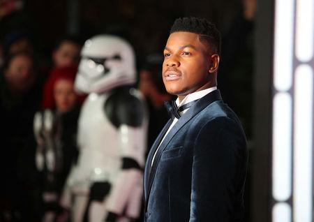 Actor John Boyega poses for photographers as he arrives for the European Premiere of 'Star Wars: The Last Jedi', at the Royal Albert Hall in central London, Britain December 12, 2017. REUTERS/Hannah McKay