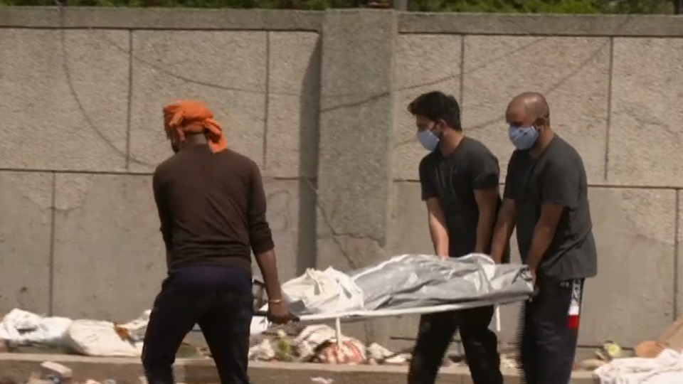 Volunteers in New Delhi collect bodies of those who died from COVID-19 and whose families could not afford cremation. / Credit: CBS News