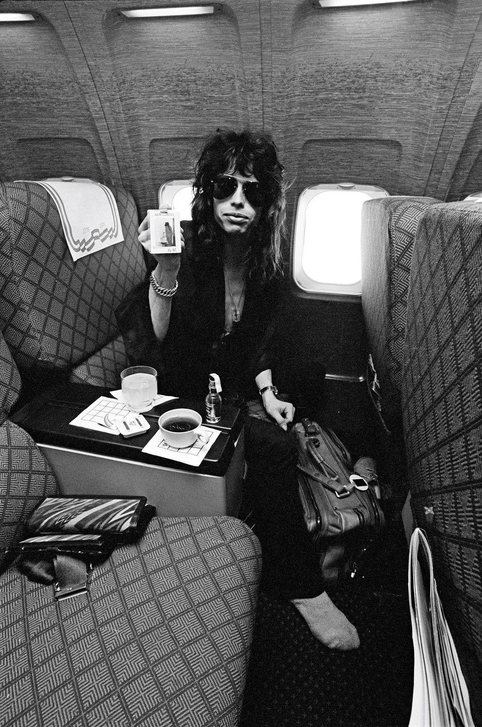 <p>Steven Tyler aboard a plane before an Aerosmith show in Michigan in 1976.</p>