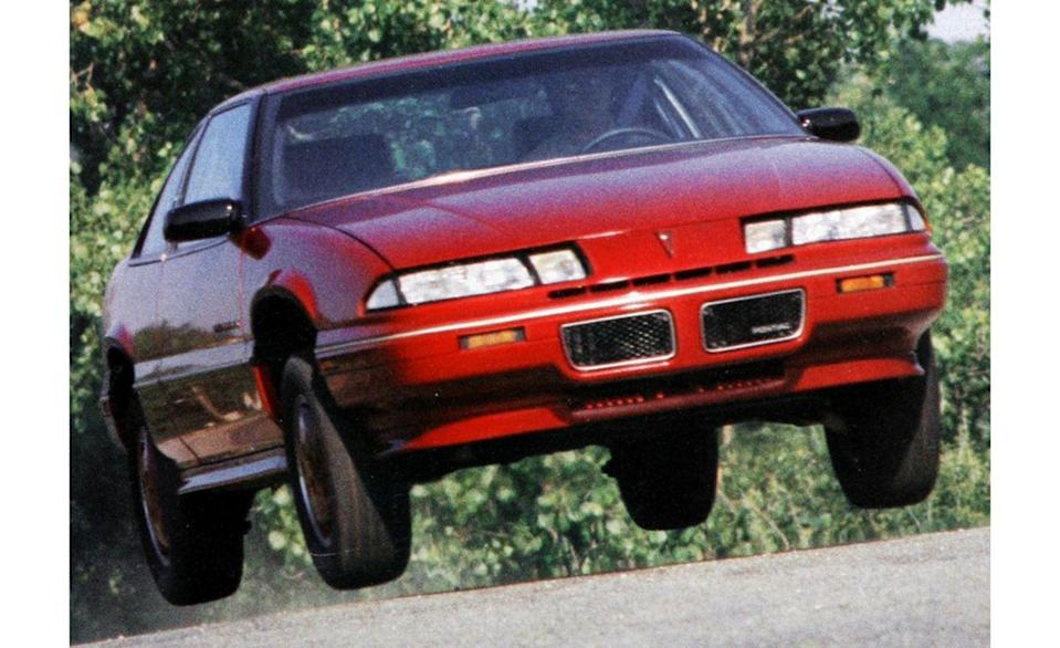 """<p>This image of a Pontiac Grand Prix coupe lifting off graced <a href=""""http://www.caranddriver.com/flipbook/like-totally-rad-the-car-and-driver-covers-of-the-1980s#95"""" rel=""""nofollow noopener"""" target=""""_blank"""" data-ylk=""""slk:the cover of our October 1987 issue"""" class=""""link rapid-noclick-resp"""">the cover of our October 1987 issue</a>. We can think of no photo more attention-grabbing for the lead story that month ('88 New Cars!) than an airborne mid-size two-door Pontiac. After all, it's not as though the other stories in that issue could have provided better eye candy. Who wants to look at a photo of the Lamborghini LM002 SUV, Saleen Ford Mustang, Ferrari Mondial 3.2, or BMW 325i convertible that we also tested that month?</p>"""