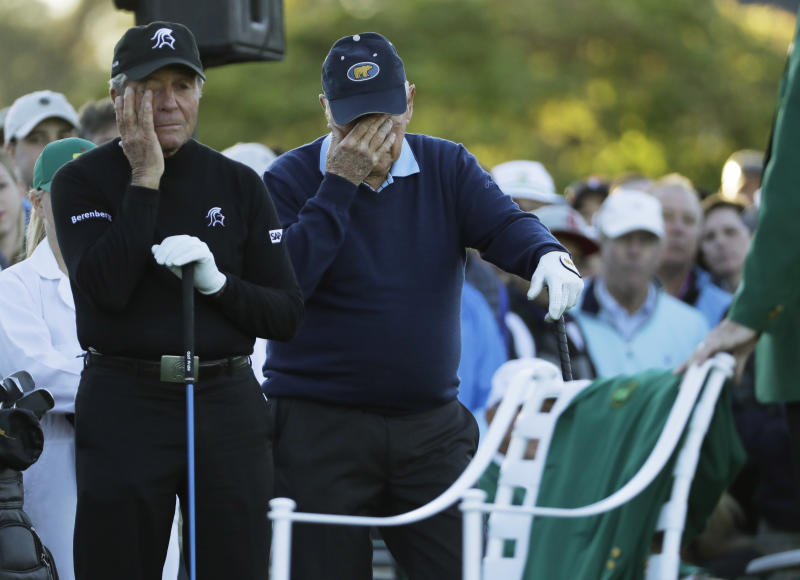 Jack Nicklaus and Gary Player wipe tears from their eyes as a chair is draped with a green jacket to honor Arnold Palmer before the start of the first round of the Masters golf tournament Thursday, April 6, 2017, in Augusta, Ga. (AP Photo/David J. Phillip)