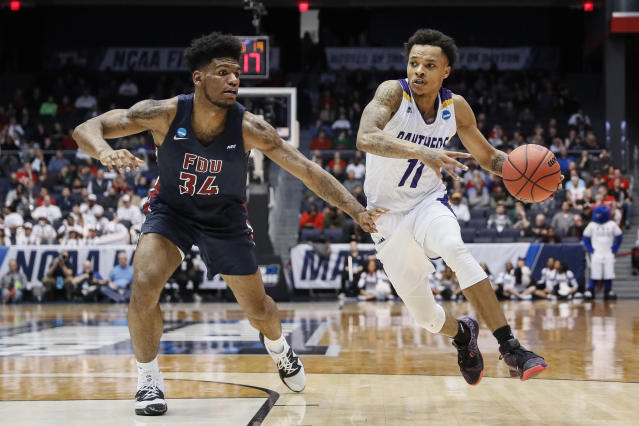 Prairie View A&M's Dennis Jones (11) drives past Fairleigh Dickinson's Mike Holloway Jr. (34) during the second half of a First Four game of the NCAA college basketball tournament, Tuesday, March 19, 2019, in Dayton, Ohio. (AP Photo/John Minchillo)