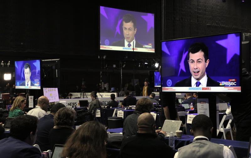 Democratic presidential candidate South Bend Mayor Pete Buttigieg is seen on television monitors in the media filing center during the fifth 2020 campaign debate at the Tyler Perry Studios in Atlanta, Georgia, U.S. November 20, 2019. REUTERS/Christopher Aluka Berry