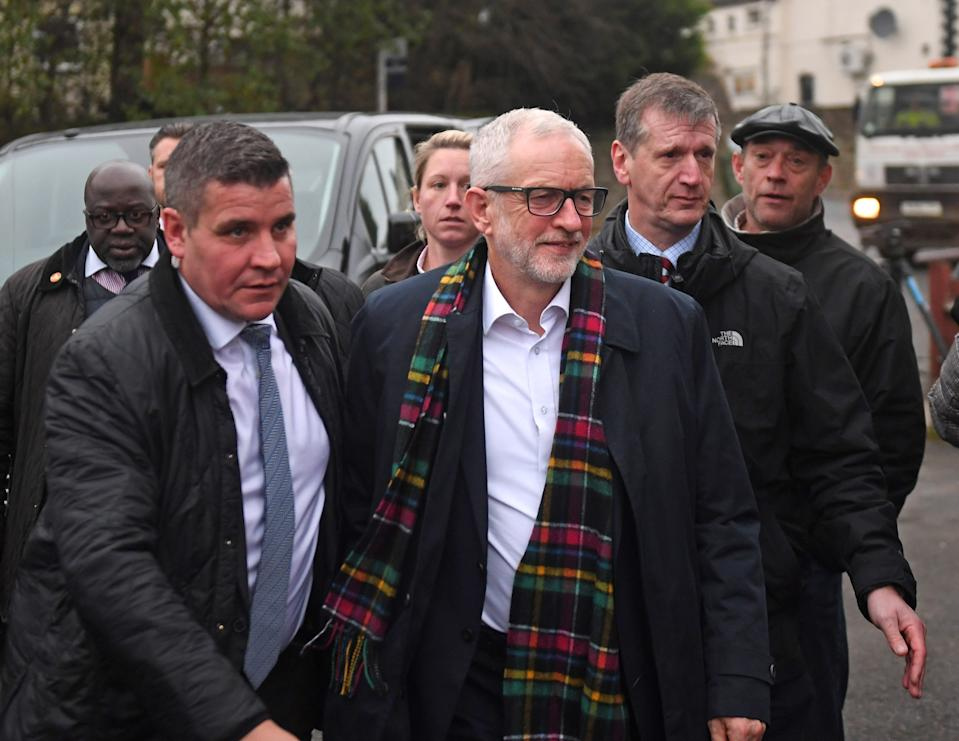 Labour Party leader Jeremy Corbyn (centre) being escorted into Dudley Pensioner Club by police after being heckled, while in Upper Gornal, West Midlands, on the General Election campaign following the launch of his party's manifesto.