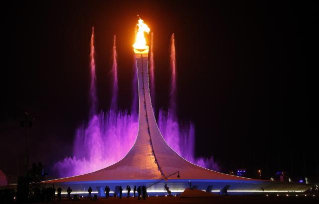 Olympic flame is surrounded by waterfalls during the opening ceremony of the 2014 Sochi Winter Olympics