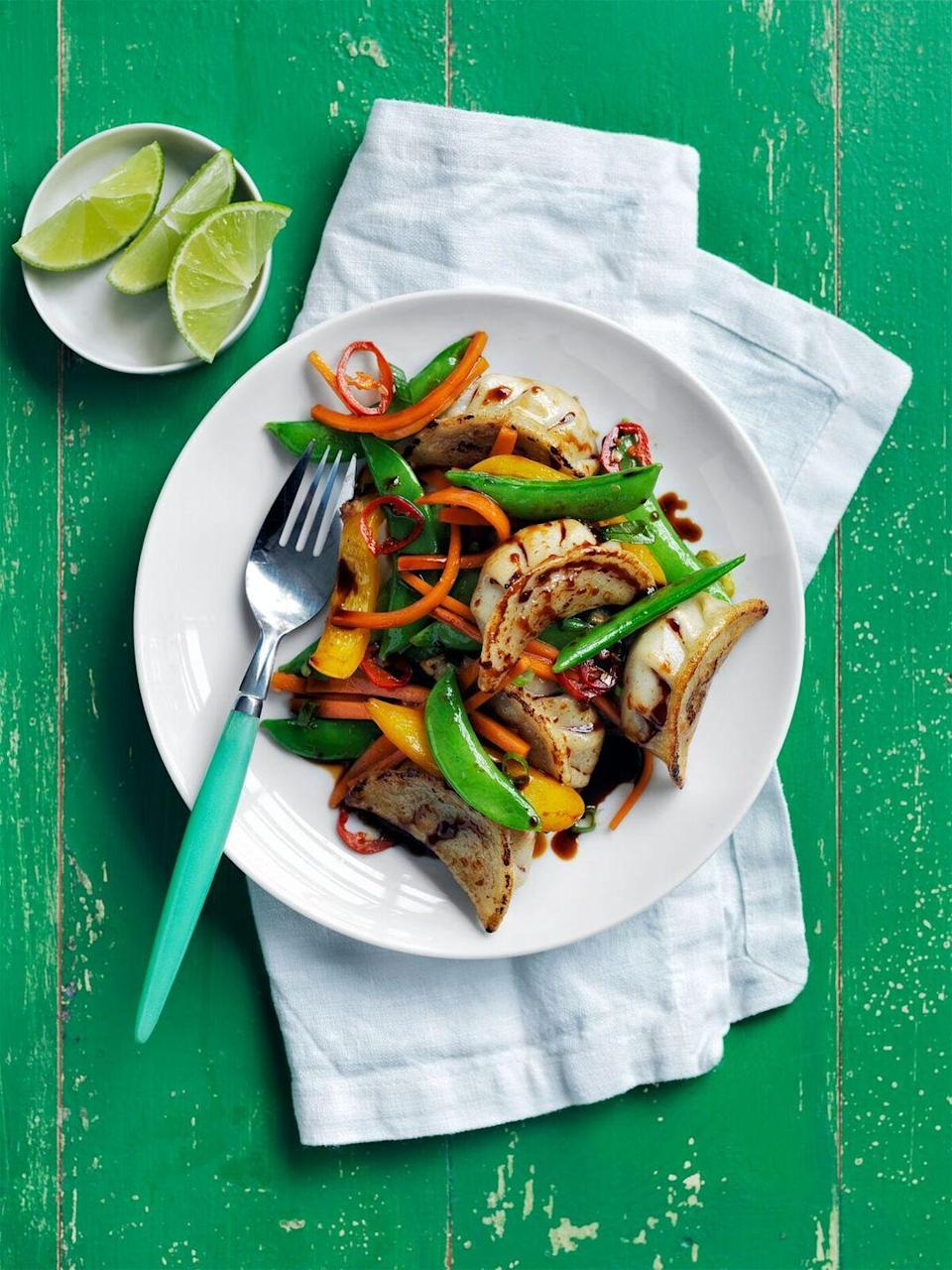 """<p>Toss together this semi-homemade, meatless main in under 30 minutes.</p><p><a href=""""https://www.womansday.com/food-recipes/food-drinks/recipes/a55780/potsticker-stir-fry-recipe/"""" rel=""""nofollow noopener"""" target=""""_blank"""" data-ylk=""""slk:Get the Potsticker Stir-Fry recipe."""" class=""""link rapid-noclick-resp""""><em>Get the Potsticker Stir-Fry recipe.</em></a></p>"""