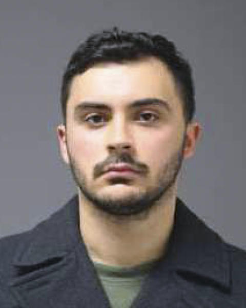This image provided by University of Connecticut Police shows a Monday, Oct. 21, 2019 booking photo of Ryan Mucaj, of Granby, Conn. Mucaj and another UConn student have been charged with shouting a racial slur outside a campus apartment complex in an episode that was caught on video and has led to protests at the school. (University of Connecticut Police via AP)