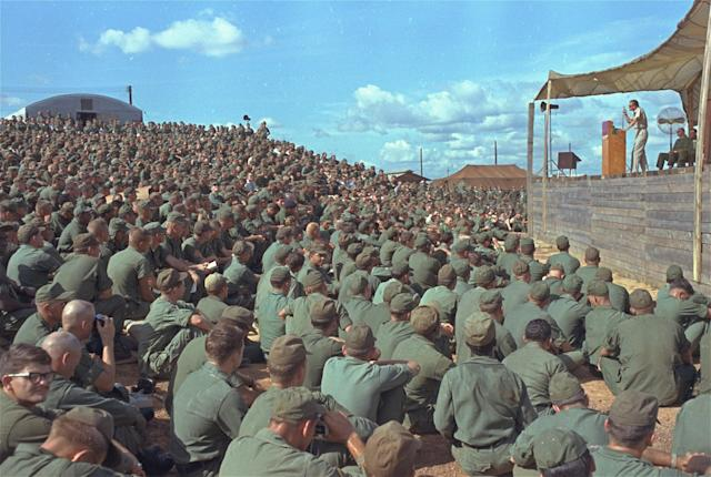 <p>Billy Graham addresses a crowd of more than 5,000 U.S. troops at Long Binh, Vietnam, Dec. 23, 1966. (Photo: AP) </p>