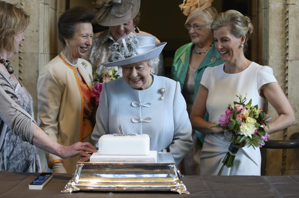 Britain's Sophie, Countess of Wessex (R) and Princess Anne (2nd L) watch as Queen Elizabeth cuts a Women's Institute Celebrating 100 Years cake, at the centenary annual meeting of The National Federation Of Women's Institute, at the Royal Albert Hall in London, Britain June 4, 2015.   REUTERS/Chris Jackson/pool