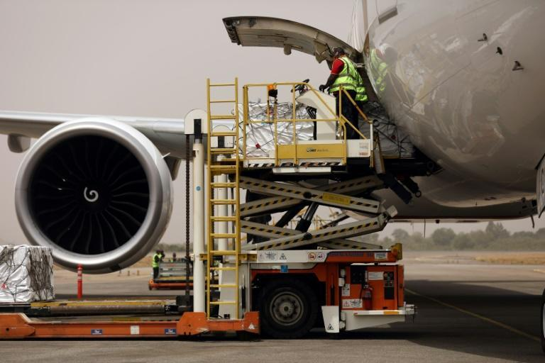 Oxford/AstraZenica Covid-19 vaccine doses are offloaded from a plane after its arrival in Abuja, Nigeria, on March 2, 2021